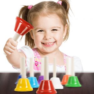 Girl Playing With 8-Note Diatonic Note Musical Hand Bell Set