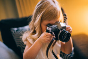 if your kid or teenager loves taking photos and is good at it he or she could sell them online on stock photo sites